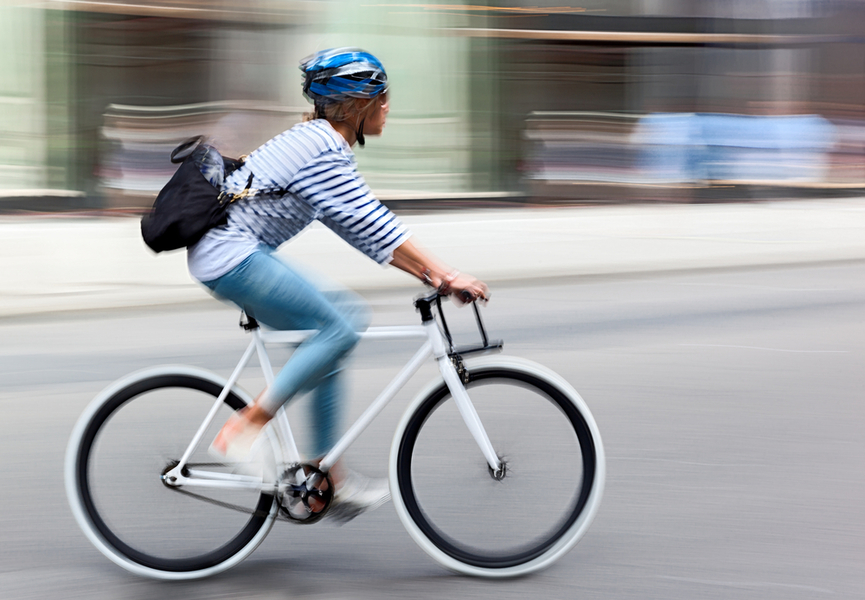 Female cyclist going quickly